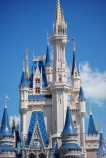 Blue trim on Cinderella's castle against a beautiful blue sky