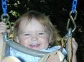 Libby LOVES swinging